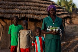 A portrait of a mother with her three children in South Sudan during the 2017 famine in East Africa