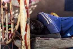 Dut lies on his bed in his home in South Sudan during the 2017 famine in East Africa