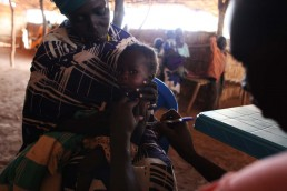 Abuk holds her baby at a feeding center in South Sudan, during the 2017 famine in East Africa