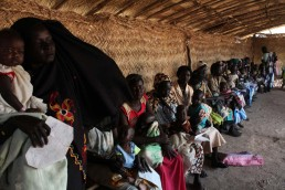 Women hold their children at a nutrition center in South Sudan, during the 2017 famine in East Africa
