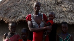 Martha and her family outside their home in South Sudan, during the 2017 famine in East Africa