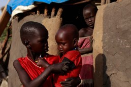 Martha's children in their neighbour's compound in South Sudan, during the 2017 famine in East Africa