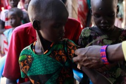 Nyaboth is measured at a nutrition clinic in South Sudan, during the 2017 famine in East Africa