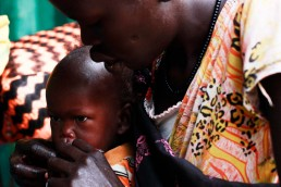 Nyabora is fed plumpy nut by her mother at a feeding clinic in South Sudan, during the 2017 famine in East Africa