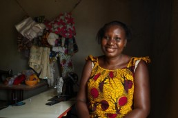 Cristelle smiles in her shop in Ivory Coast, as she explains how Mobile Money has helped her business grow