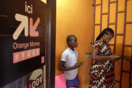 Nadege withdraws money from a kiosk using her Mobile Money account in Ivory Coast