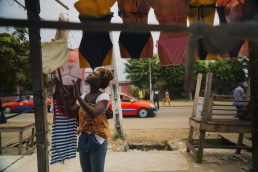 Katy tends to her shop in Ivory Coast, as she explains how Mobile Money has improved her life