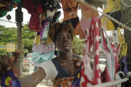 Katy tends to her shop in Ivory Coast as she explains how Mobile Money has improved her business