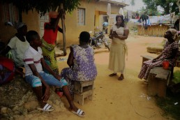 Elyse uses Mobile Money on her phone in her remote village in Ivory Coast
