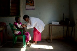 A health worker with GAVI vaccinates a boy against measles and rubella in Tanzania