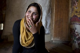 A Syrian refugee poses for a portrait in Lebanon