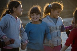 Young Syrian refugee girls play in the evening light in Lebanon