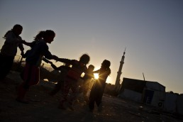 Syrian refugee girls play at sunset in Lebanon